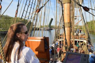 Captain Lauren Morgens at the helm