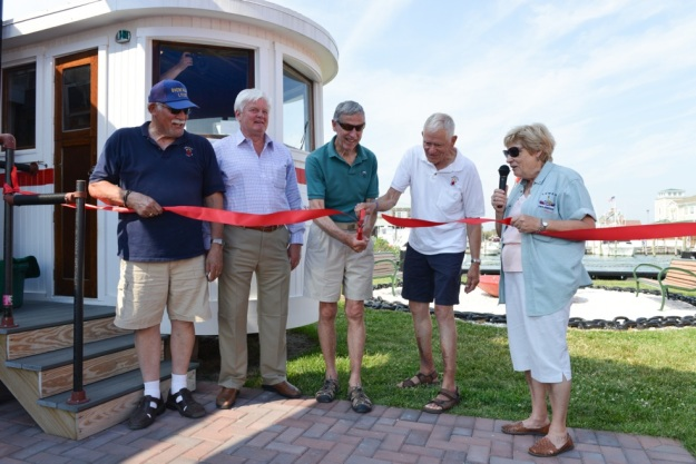 Cutting the ribbon on the Overfalls Foundation's new American Lightship Museum from the left: Museum Curator Ray Glick, Mayor Ted Becker, Foundation Ship & Grounds Chair Bill Reader, Past President Dave Bernheisel and President Tracy Mulveny